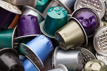 environmental issue: Dumped plastic and metal espresso coffee capsules environmental issue