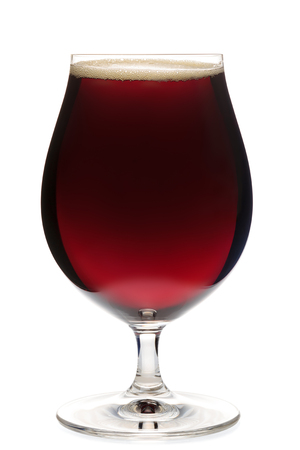 ipa: Full snifter glass of dark ale or porter beer isolated on white background