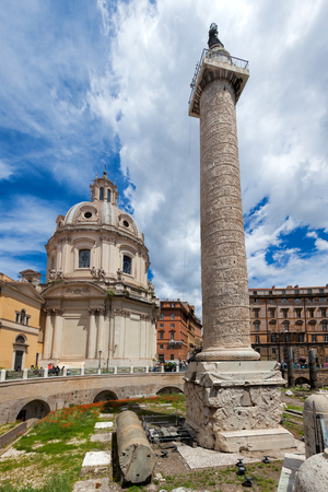 column: Trajans Column and Church of the Most Holy Name of Mary at the Trajan Forum Stock Photo