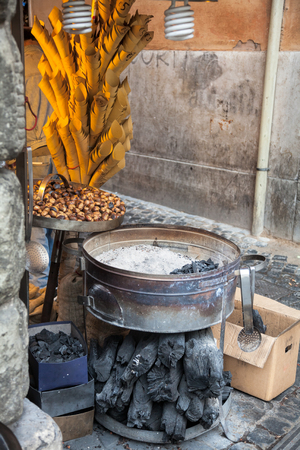 vendor: Street vendor equipment for roasting chestnuts on a charcoal Stock Photo