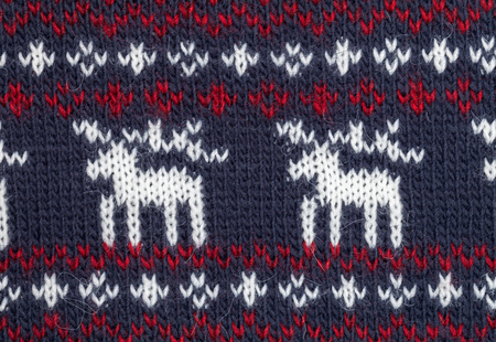 sample: Deep blue knitted fabric with moose or elk ornament