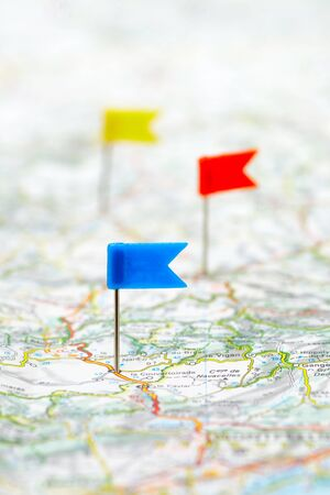 poi: Three color flag pins on a map as travel destinations concept Stock Photo