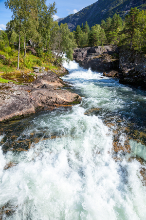 upstream: Norwegian landscape with whitewater