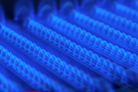 Propane flame inside of gas boiler furnace Stock Photo