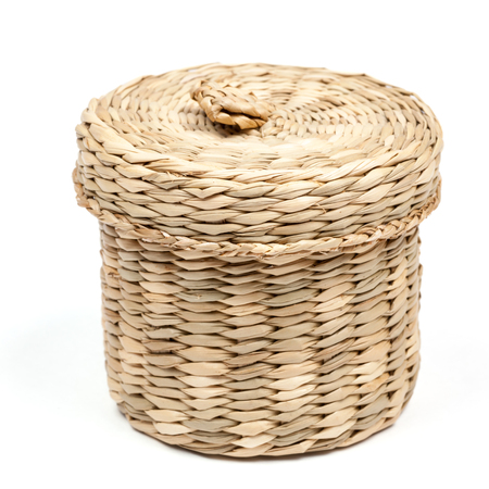 Small hand made rattan box on white background