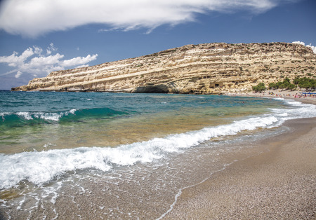 Matala beach and lagoon with sandstone cliffs and turquoise waters of the Libyan Sea near Heraklion in Crete,  Greece, Mediterranean