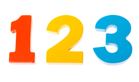 Colorful wooden toy numbers one two three on white background