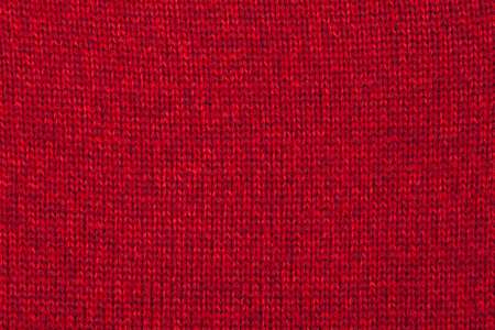 Real red knitted fabric made of heathered yarn textured background Stock Photo