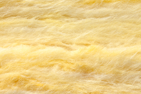 Mineral wool (or mineral fiber, mineral cotton, mineral fibre, glass wool, MMMF, MMVF) fiber thermal insulation batts close-up