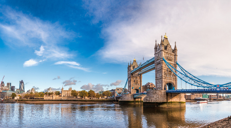 Panoramic London skyline with iconic symbol, the Tower Bridge and Her Majesty's Royal Palace and Fortress, known as the Tower of London as viewed from South Bank of the River Thames in the morning light Redakční