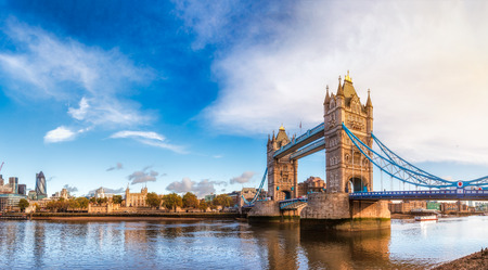 Panoramic London skyline with iconic symbol, the Tower Bridge and Her Majestys Royal Palace and Fortress, known as the Tower of London as viewed from South Bank of the River Thames in the morning light Reklamní fotografie