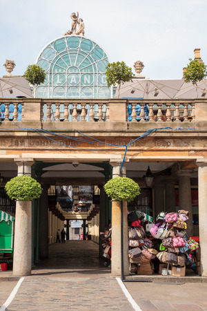 LONDON, UK - JUNE 18, 2013: Entrance to Covent Garden Market, one of the main tourist attractions in London
