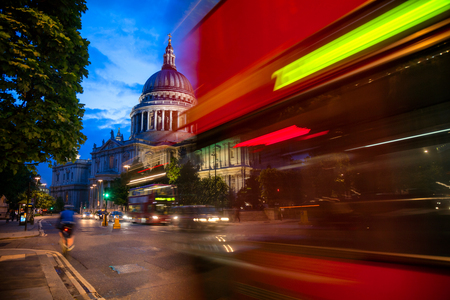 London cityscape with Double Decker bus moves along the Cannon Street near St Pauls Cathedral in twilight Editorial