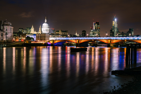 London skyline with illuminated Blackfriars Bridge over the River Thames and The St Pauls Cathedral at night
