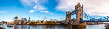 Panoramic London skyline with iconic symbol, the Tower Bridge and Her Majestys Royal Palace and Fortress, known as the Tower of London as viewed from South Bank of the River Thames in the morning light Stock Photo