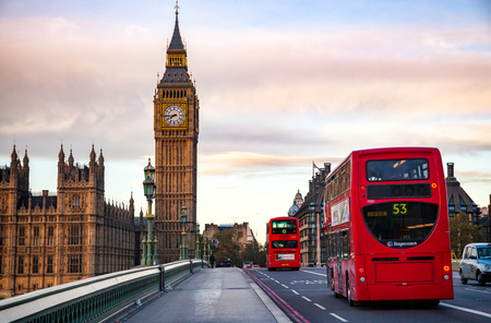 LONDON, UK - NOVEMBER 03, 2012:  Red Double Decker buses move along the Westminster Bridge with Elizabeth Tower or Big Ben in background