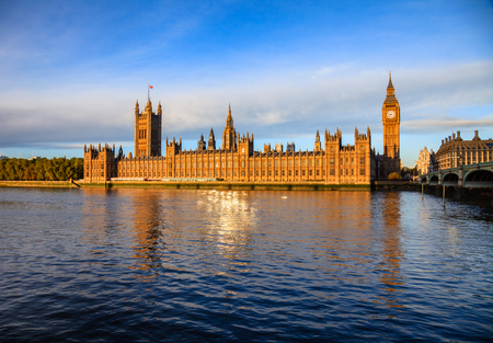 London cityscape with Palace of Westminster, Elizabeth Tower aka Big Ben and the Westminster Bridge over the River Thames  in a morning light