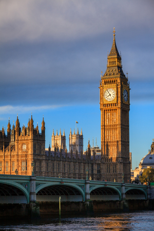 Palace of Westminster with Elizabeth Tower aka Big Ben and Westminster Bridge over the River Thames  in a morning light, London, UK Stock Photo