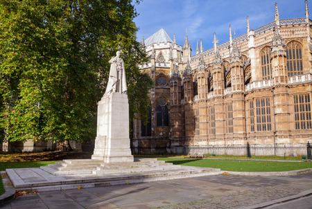 Statue of George V, King of the United Kingdom and the British Dominions, and Emperor of India in Old Palace Yard with Westminster Abbey in background, City of Westminster, Central Area of Greater London, UK
