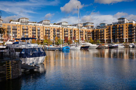LONDON, UK - NOV 1, 2012: A popular housing and leisure complex with yachting marina in the St Katharine Docks, North Bank of the river Thames, London Borough of Tower Hamlets 報道画像