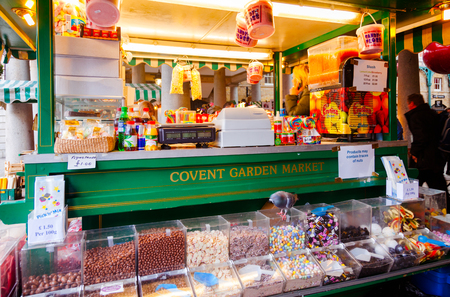 LONDON, UK - OCT 31, 2012: Confectionery stall selling candy floss and other sweets at Covent Garden Market, one of the main tourist attractions in London