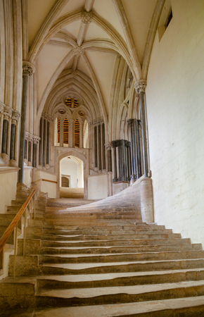 Wear-out stairs to the Chapter House and Vicars Close of Wells Cathedral (Cathedral Church of Saint Andrew) in Somerset, South West England, UK