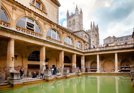 BATH, UK - JUN 11, 2013: VIsitors at Roman Baths Great Bath