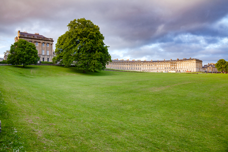 View of the Royal Crescent, a row of 30 terraced houses laid out in a sweeping crescent, one of the  greatest examples of Georgian architecture in Bath, Somerset, South West England, UK