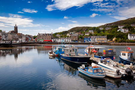 Moored boats at Tarbert Harbour. Tarbet, a small fishing town and ferry terminal in Argyll and Bute, Scotland, UK,