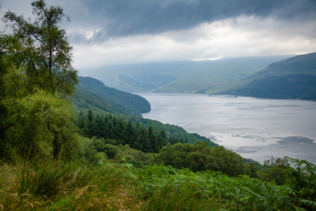 Stormy sky over Loch Goil Marine Protectrd Aria at Loch Lomond and The Trossachs National Park in Argyll and Bute, Scotland, UK 版權商用圖片