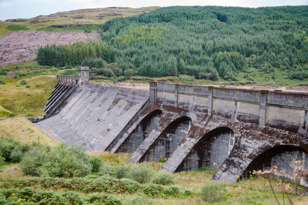 Dam on freshwater Loch Tarsan lake used as impounding reservoir supplying water to the Striven Hydro-Electric Scheme, Argyll and Bute, Scotland, UK