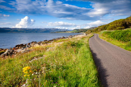 Scenic winding road along the sea Loch Caolisport at Kintyre peninsula, Argyll and Bute, Scotland, UK 写真素材