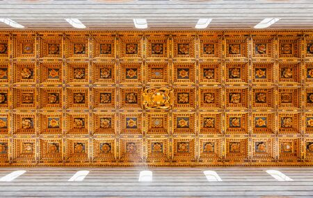 PISA, ITALY - MAY 31, 2018: Wooden coffered ceiling of Roman Catholic Pisa Cathedral at Piazza dei Miracoli (Piazza del Duomo), an important center of European medieval art and famous UNESCO World Heritage Site 에디토리얼