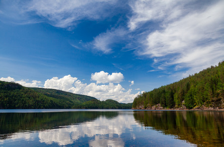 Bright summer day at freshwater Lake Langen in Telemark County, Southern Norway Stock Photo