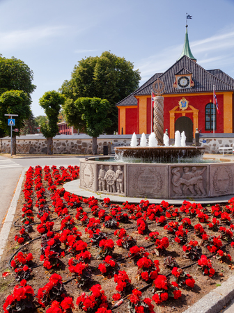 Stavern townscape with World War II Memorial fountain made of local granite and renaissance baroque Stavern church. Stavern is a popular travel destination on the Southern Norway seacoast