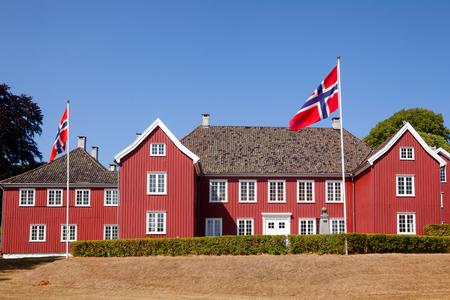 Red colored wooden Herregarden Manor House, one of Norway's finest secular Baroque structures in Larvik, Vestfold County, Norway Standard-Bild - 113620074
