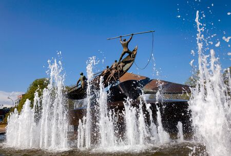 SANDEFJORD, NORWAY - JULY 21, 2018: The Whaler's Monument (The Whaling Monument), a rotating bronze memorial statue and fountain by Norwegian sculptor Knut Steen representing Sandefjord as the capital of the whaling industry