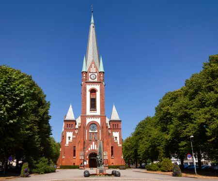 SANDEFJORD, NORWAY - JULY 21, 2018: Sandefjord Church and World War  Memorial in the city center