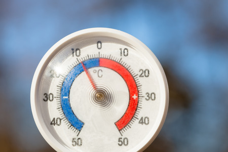 Outdoor thermometer with celsius scale showing severe freezing temperature cold winter weather concept Stock Photo
