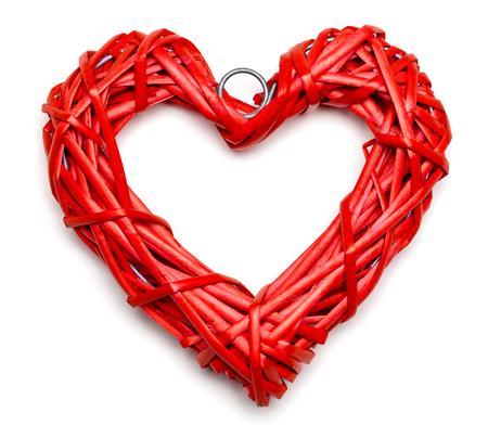 Red heart shaped braided wicker on white background Standard-Bild - 113610754