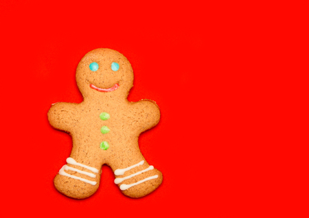 Iced Christmas Gingerbread man sugar cookie on red background Standard-Bild - 113610764
