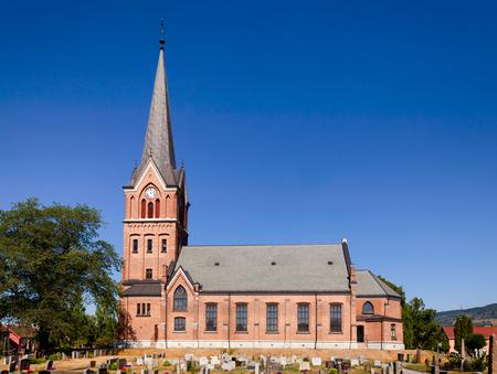 Red brick-built Gothic Revival Lillehammer Church (Lillehammer Kirke) Oppland Norway Standard-Bild - 113610835