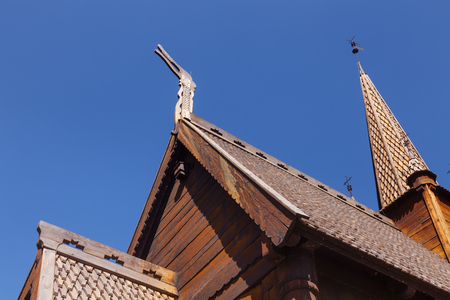 Reconstructed wooden Garmo Stave Church (Garmo Stavkyrkje) in Maihaugen Folks museum, Lillehammer, Oppland, Norway, one of the most visited stave churches in Norway Standard-Bild - 113610836