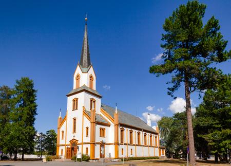 White wooden Neo-Gothic Gjovik Church (Gjøvik kirke) Oppland Norway Standard-Bild - 113610840