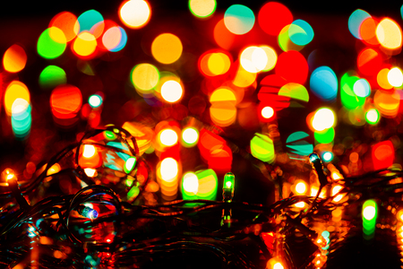Blurred christmas or fairy lights christmas decoration background, focus on electric light bulbs Standard-Bild - 113610853