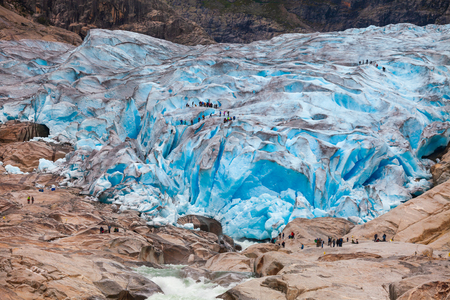 Tourists visit the Nigardsbreen Glacier, an arm of the Jostedalsbreen glacier, Jostedalsbreen National Park, Sogn og Fjordane, Norway, Scandinavia
