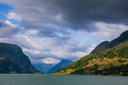 Cloudy sky over the Lustrafjord or Lustrafjorden fjord, branch of greater Sognefjord or Sognefjorden (the King of the Fjords), the largest and deepest fjord in Norway. Luster municipality, Sogn og Fjordane, Norway, Scandinavia Stock Photo