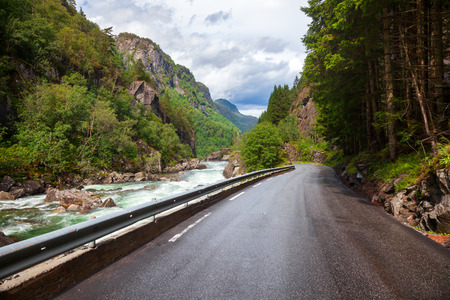 Scenic tourist route Norwegian National Road 13 along the Gronsdalslona river Odda , Hordaland county, Norway, Scandinavia Stock Photo