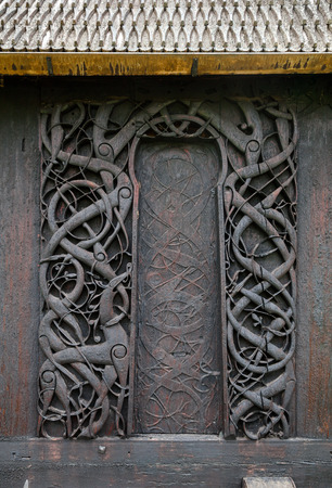11-th century wooden carvings on door jambs of Urnes Stave Church (Urnes stavkyrkje), and one of the oldest remaining stave churches in Norway. Ornes, Luster, Sogn og Fjordane county, Norway Stock Photo