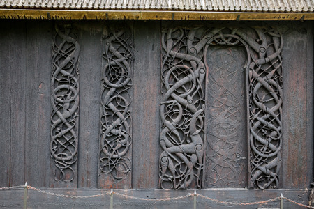 11-th century wooden carvings on wall planks and door jambs of Urnes Stave Church (Urnes stavkyrkje) Stock Photo